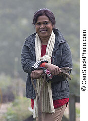 Happy woman working in her allotment - Portrait of a female...