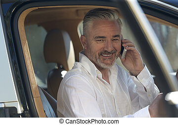 Happy businessman making a call - Businessman making a quick...