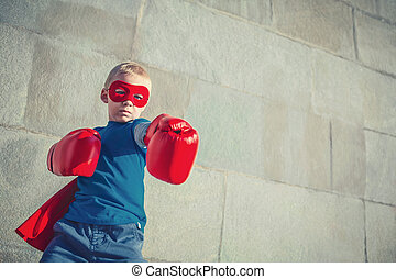 Strength - Little boy with boxing gloves