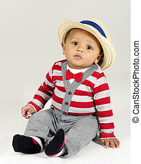 Dressed Up Baby Boy - An adorable baby born sitting in his...