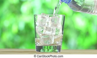 Water Bottle and Glass Of Ice Cubes - Cold Water Bottle and...