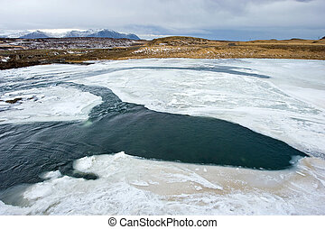 River in Iceland - A river with a lot of ice in Iceland in...