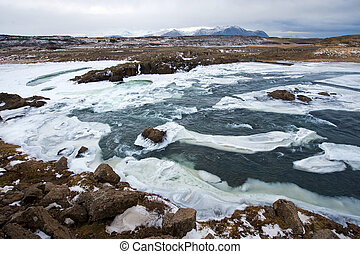 Wild river in Iceland - A wild river with a lot of ice in...