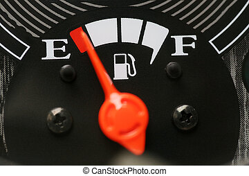 Fuel gauge with warning indicating low fuel tank. - Fuel...