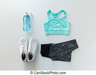 close up of female sports clothing and bottle set - sport,...