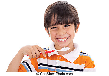 Closeup of cute kid brushing his teeth on isolated white...