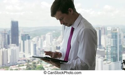 25 Person Using Tablet PC Looking Out Of Office Window -...