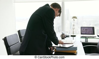 28 Portrait Of White Collar Worker With Tablet PC In Office...