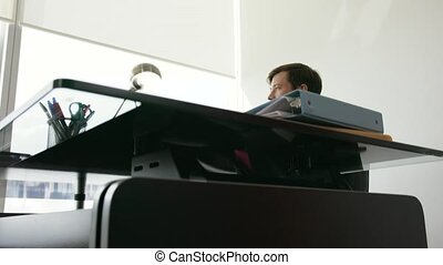 Portrait Of White Collar Worker Smiling In Office - Adult...