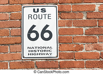 US Route 66 National Historic Highway sign on red brick...