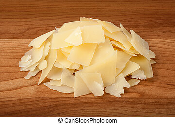Shaved Parmesan Cheese on a cu - Shaved Parmesan Cheese on a...