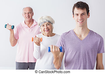 Elderly couple with personal trainer