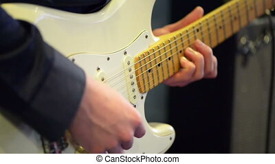 Electric guitar - Man playing electric guitar on a stage