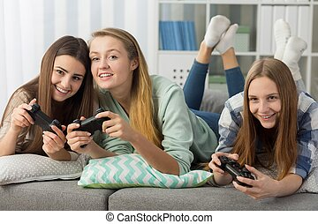 Teenage friends playing together - Photo of happy teenage...