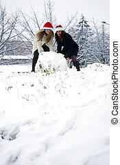 snowball - two girls making big snowball