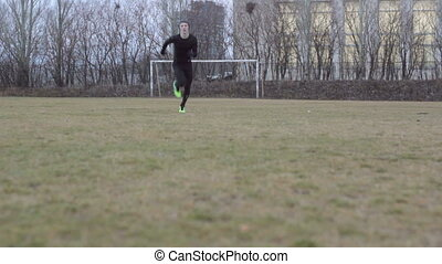 Winter  football player running  at cold day.