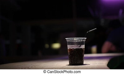 man in nightclub take coke from bar - man take with ice coke...