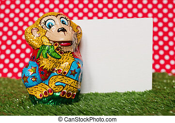 Chocolate monkey in a wrapper - A chocolate figure of monkey...