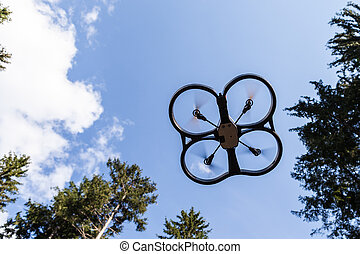 High up drone - a small spy quad copter scout drone flying...