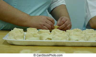 rolling dough and making dumplings
