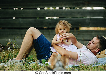 Happy family on lawn in the park