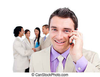 Portrait of an attractive businessman on phone in front of...