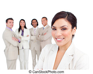 Portrait of latin businesswoman smiling with his team