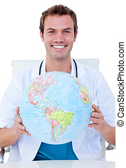 Portrait of a smiling male doctor holding a terrestrial...