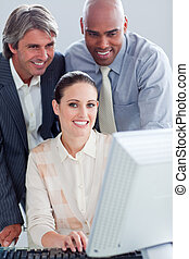 Portrait of a businesswoman and her colleagues working at a computer in the office