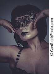 sensual and seductive woman with mask