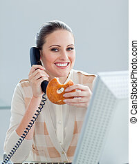 Self-assured businesswoman talking on phone in the office