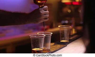 whiskey with coke at bar - bartender prepare two glasses of...