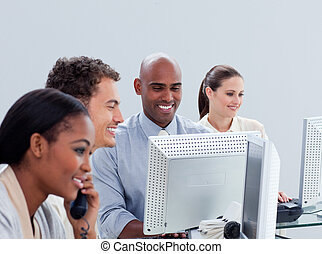 Ambitious business group working hard in the office in a...