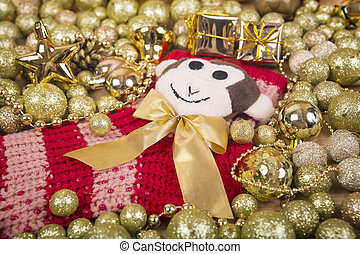 Christmas background with gold balls and monkey on red sox....