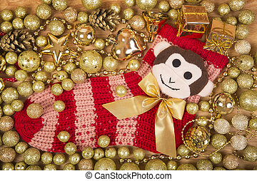 Christmas background with gold balls and monkey on red sox -...