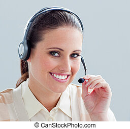 Close-up of a businesswoman with headset on in the office