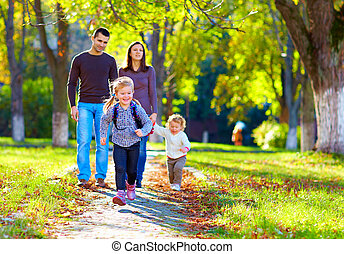 happy family on walk in park