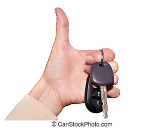 Driver hand with a car key. - Driver hand with a car key...