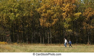 Couple Walking Against Trees - Couple Walking in autumn papk