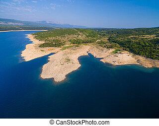 Aerial view of Peruca lake shore, Croatia.