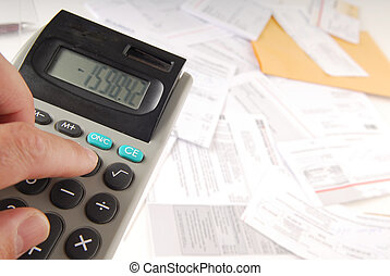 Bills - Pile of bills with calculator displaying minus