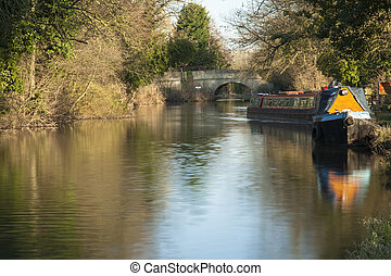 Barges moored along the towpath of the River Kennet and...