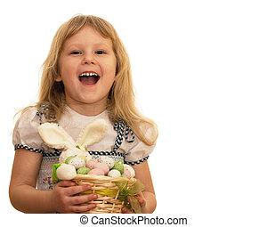 Laughing little girl holding Easter basket