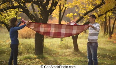 Couple Preparing for Picnic