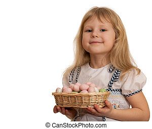 Smiling little girl holding Easter basket with eggs