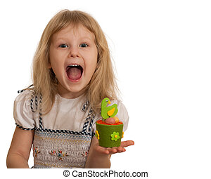 Expressive little girl with Easter toy - An expressive...