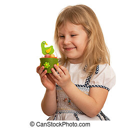 Smiling girl with Easter toy