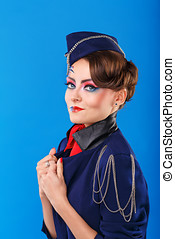 Stewardess with face art corrects jacket Young attractive...
