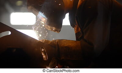 Welding Engineer weld metal bright sparks, smoke and light...