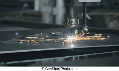 CNC LPG cutting with sparks close up metal manufacture...